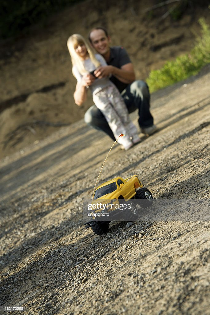 Child Girl and Father Playing with Remote Car Summer Lifestyle : Stock Photo