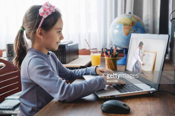 child girl attending online class for school, remote education, e-learning concept for coronavirus pandemic period - attending stock pictures, royalty-free photos & images