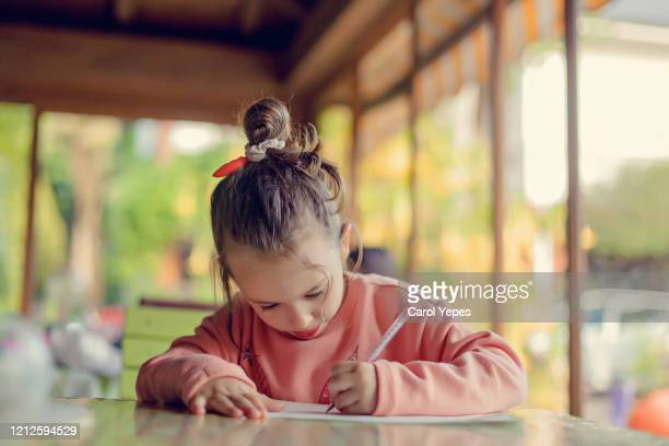 child girl drawing picture outdoors - drawing activity stock pictures, royalty-free photos & images