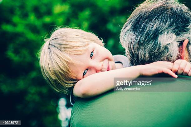 Child giving his Grandpa a hug