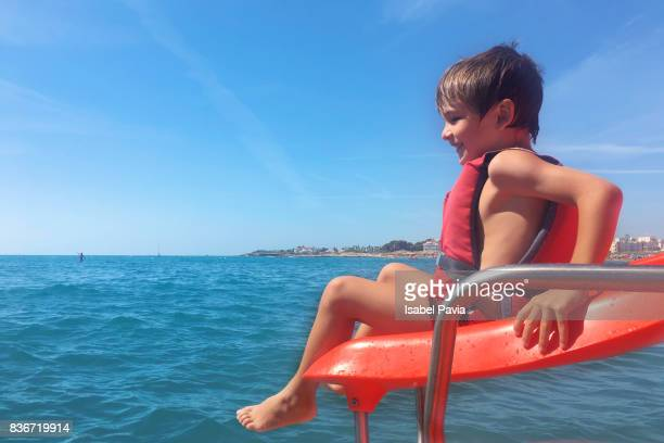 Child going down from water slide to the sea