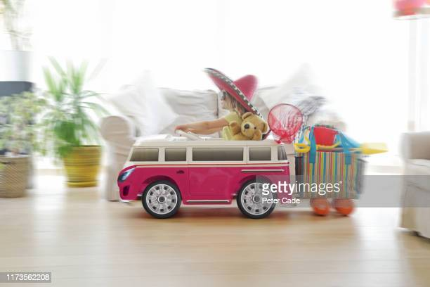 child going on holiday in toy car - road trip stock pictures, royalty-free photos & images