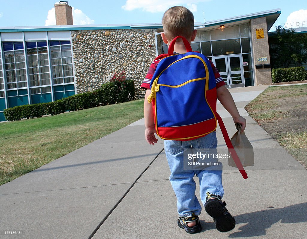 Child Going to School in Primary Colors : Stock Photo