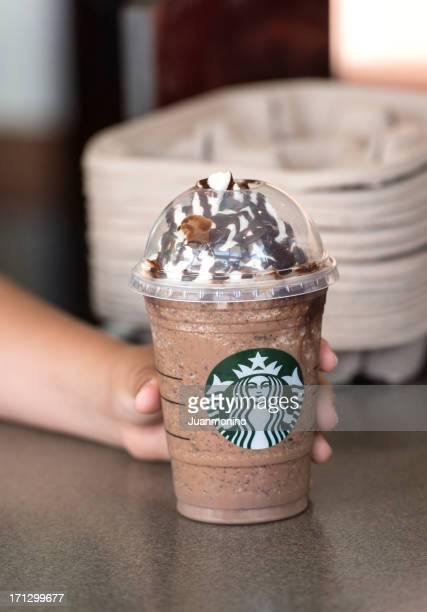 Child hand holding a coffee Frappuccino