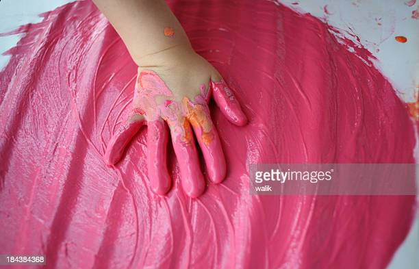 Child hand in pink