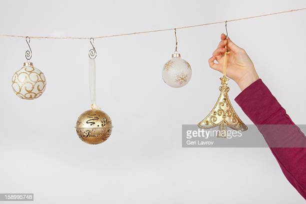 Child hanging ornaments on a string