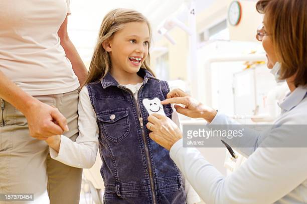 Child happily being rewarded by the dentist