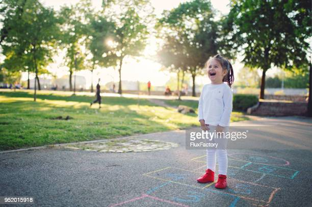 child happiness - hopscotch stock pictures, royalty-free photos & images