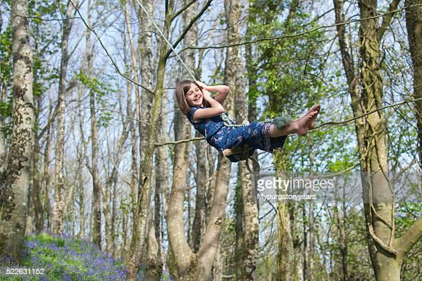 Child happy on a tree swing