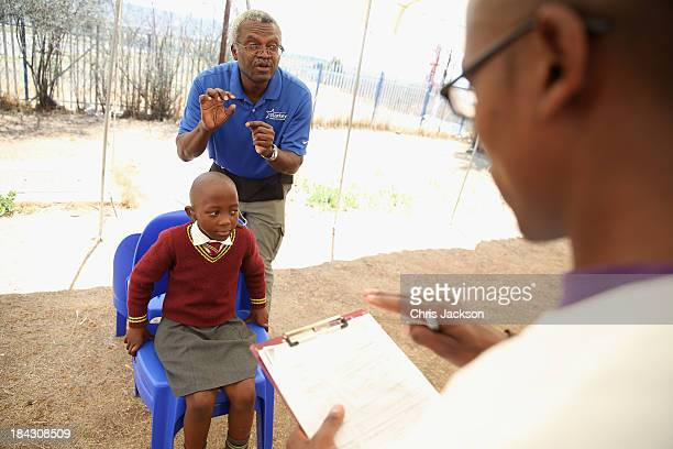 Child has a hearing aid fitted by the Starkey Foundation at Lesotho Cooperative College on October 10, 2013 in Maseru, Lesotho. Prince Harry's...
