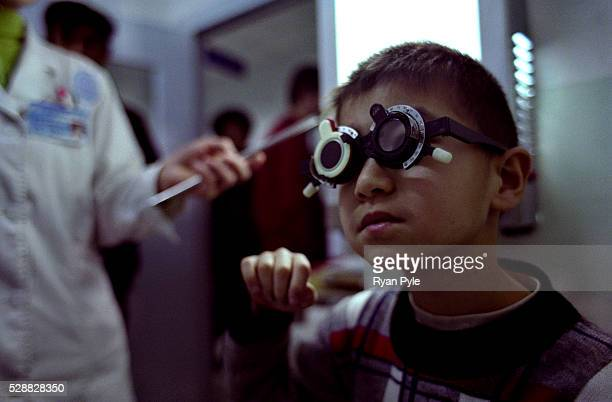 A child has his eyes tested at the Aydia Ophthalmological Hospital in Urumqi Xinjiang in Northwestern China