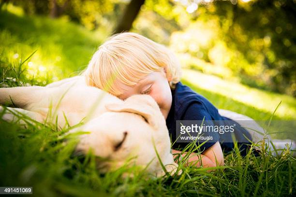 Child having a nap with puppy