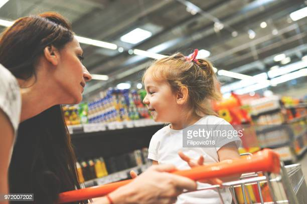child having arguement with mother at candy counter - mother scolding stock pictures, royalty-free photos & images