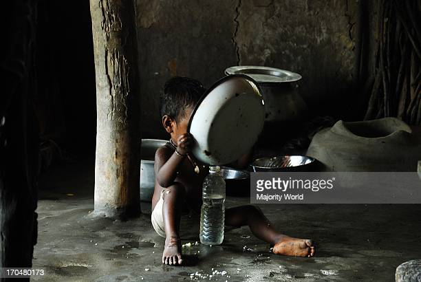 A child having food at his home in a village in Suandarban in West Bengal India