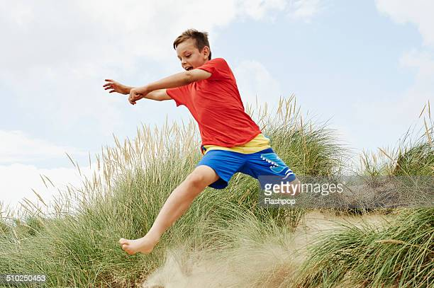 child having fun at the beach - one boy only stock pictures, royalty-free photos & images