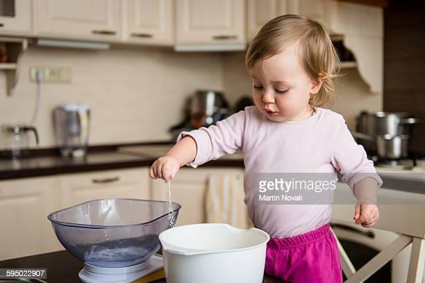 Child having fun in kitchen