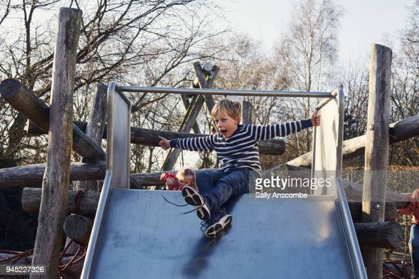 Child having fun playing on a slide