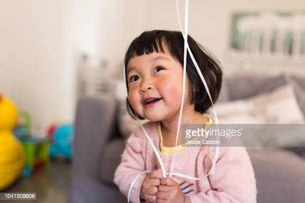 child having fun with her birthday balloons - chinese decoration stock pictures, royalty-free photos & images