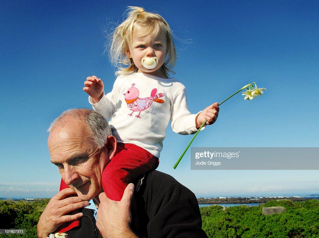 Child Having Shoulder Ride with Granddad : Stock Photo