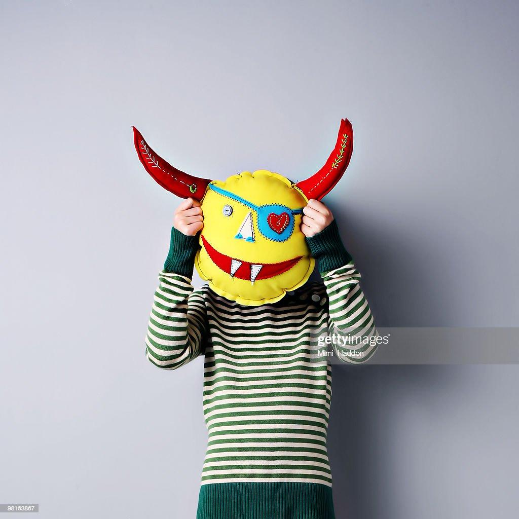 Child Hiding Behind Mask : Stock Photo