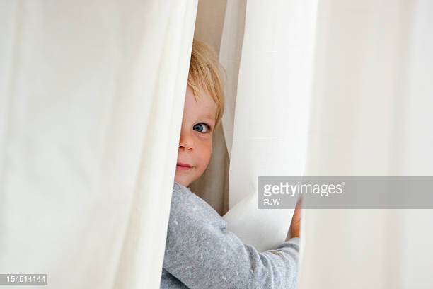 Child Hiding in Curtain