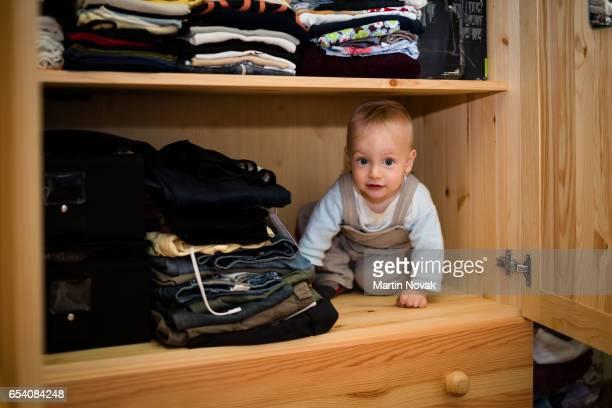 Child hiding in wardrobe