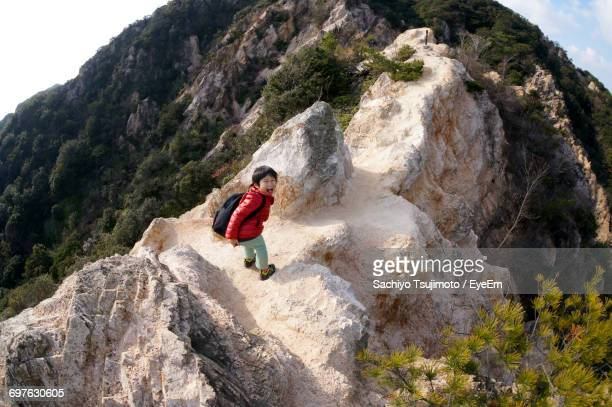 Child Hiking On Mountain
