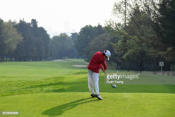 A child hits the ceremonial first tee shot during opening ceremonies before round one of the World Golf ChampionshipsMexico Championship at Club de...