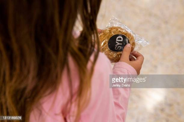Child hold an anzac biscuit at Sydney International Airport on April 19, 2021 in Sydney, Australia. The trans-Tasman travel bubble between New...
