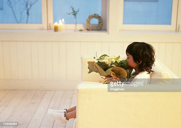 Child holding a bunch of flowers