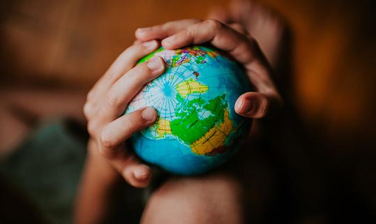 Child holding a globe - gettyimageskorea