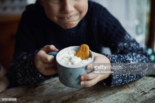 Child holding a hot chocolate drink