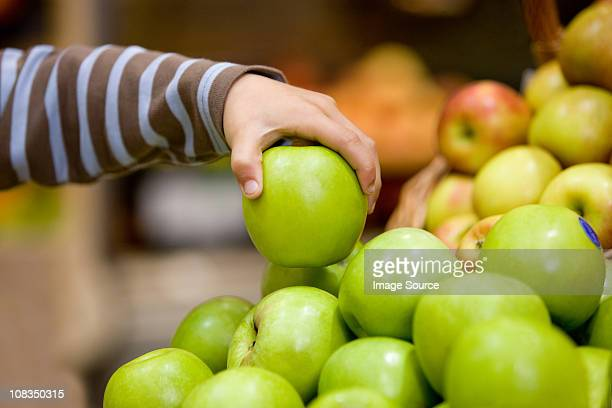 child holding an apple - apple fruit stock photos and pictures