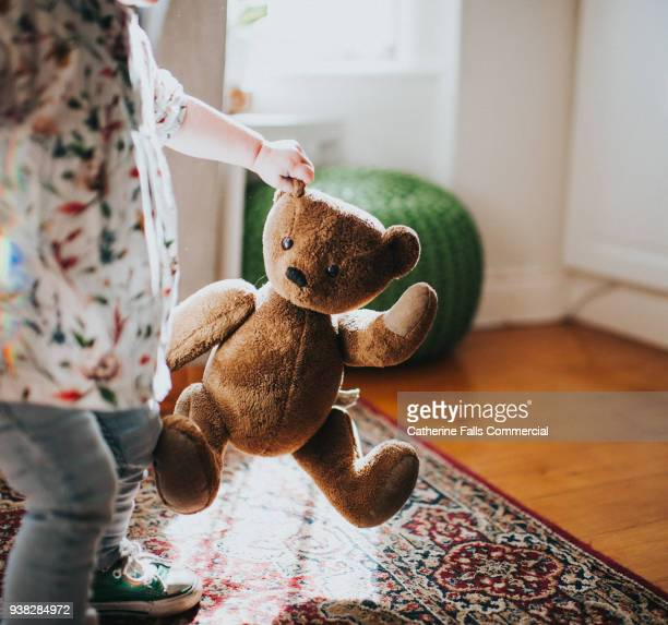 child holding brown teddy - stuffed toy stock pictures, royalty-free photos & images