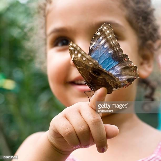Child Holding Butterfly Speckled Wood ( Pararge aegeria )