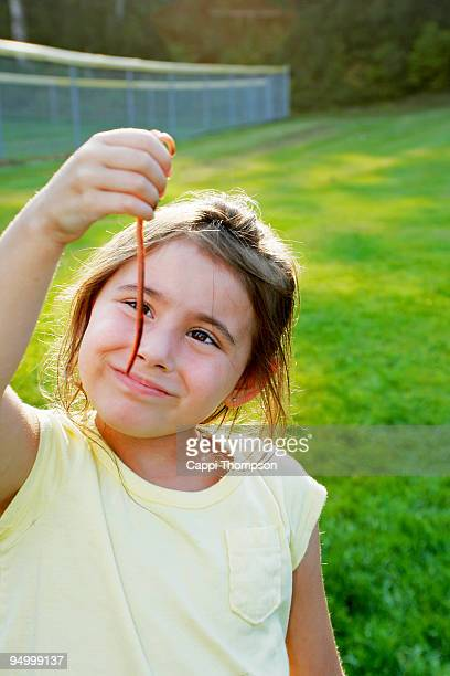 Child holding earthworm
