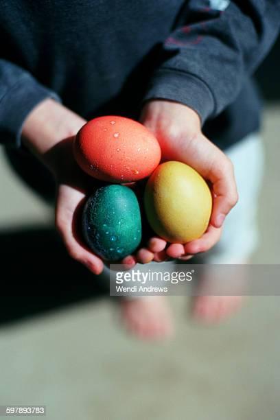 Child holding Easter eggs