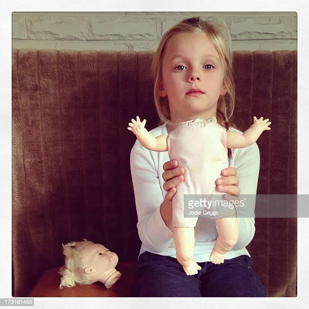 child holding headless doll - puppe stock-fotos und bilder