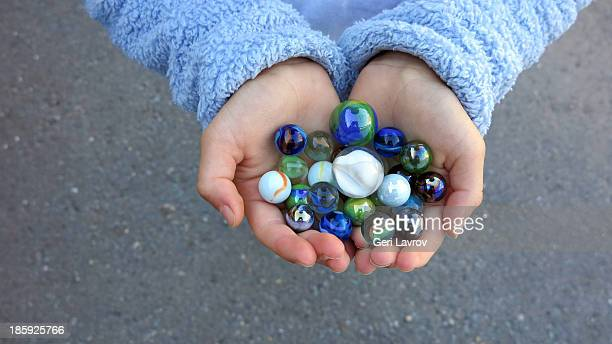 Child holding marbles in hands