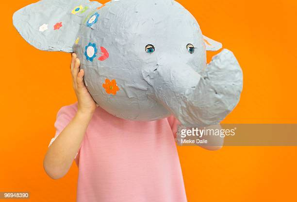 child holding paper elephant