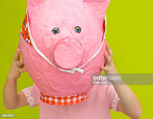 child holding paper pink pig - one boy only stock pictures, royalty-free photos & images