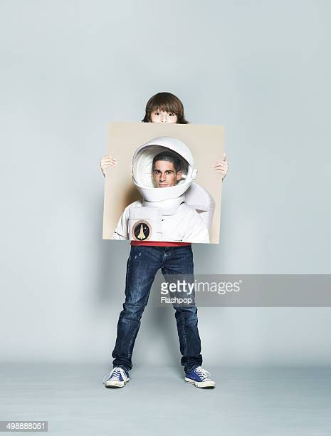 Child holding picture of inspirational person