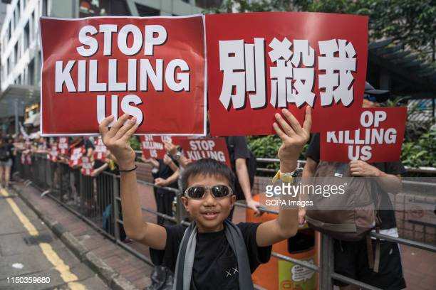 A child holding placards reads Stop killing us during the anti extradition law protest Despite the Chief Executive Carrie Lam's attempt to ease the...