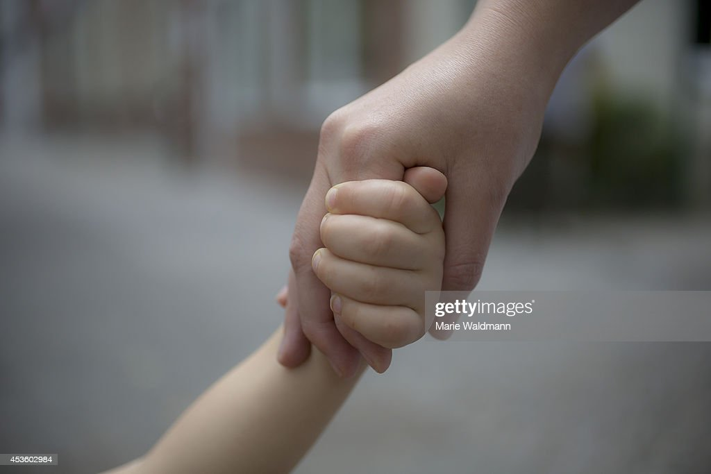 Close-up Of Two Hands : News Photo