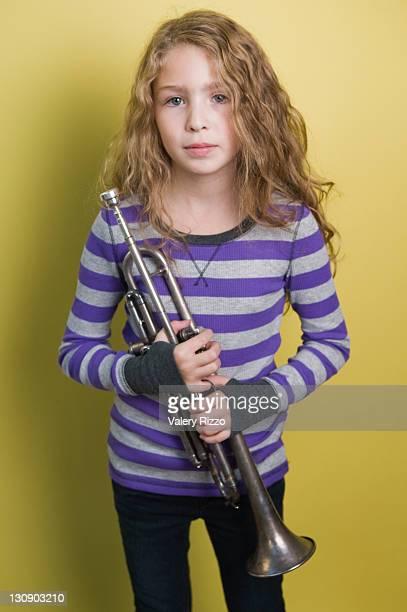 Child Holding Trumpet