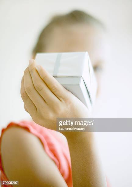 Child holding up gift
