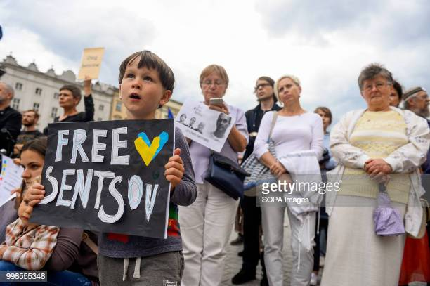 A child holds a banner saying Free Oleg Sentsov during the protest Protest demanding the release of the Ukrainian filmmaker and writer Oleg Sentsov...