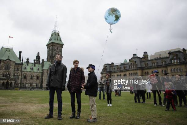 A child holds a globe balloon during the March for Science rally on Earth Day at Parliament Hill in Ottawa Ontario Canada on Saturday April 22 2017...