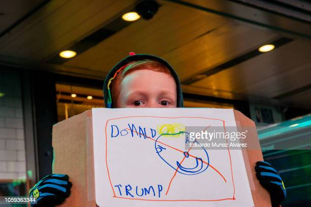 A child holds a hand drawn protest sign during a protest the day after President Donald Trump forced the resignation of Attorney General Jeff...