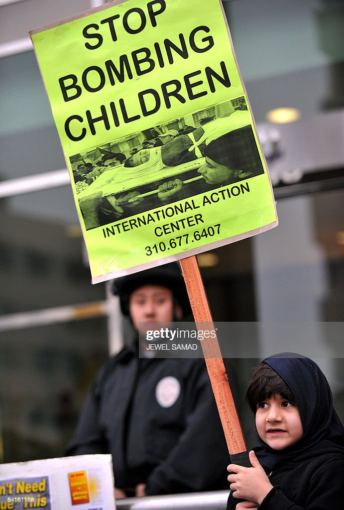 A child holds a placard as she joins with other protesters during an anti-Israeli demonstration in front of the Israli consulate in Los Angeles, California, on January 2, 2009. US President George W. Bush urged all able parties to press Hamas to stop firing rockets at Israel and secure a lasting ceasefire, after a week of heavy Israeli air strikes on the Gaza Strip. AFP PHOTO/Jewel SAMAD